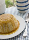 Steamed Syrup Sponge With A Jug Of Custard