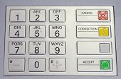 stock photo of automatic teller machine  - Metallic keypad of an automated teller machine - JPG