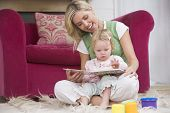 pic of lounge room  - Woman at home reading with baby - JPG