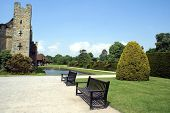 picture of hever  - wooden benches on a gravel pathway in front of hedge - JPG