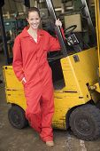 picture of forklift driver  - Two warehouse workers in forklift - JPG