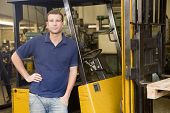 foto of factory-worker  - Warehouse worker in forklift - JPG