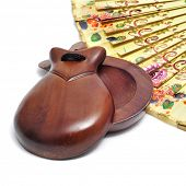 stock photo of castanets  - spanish castanets and hand fan on a white background - JPG