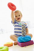 Baby Indoors Playing With Soft Toy poster