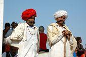 Two Rajasthani tribal men wearing traditional turbans attend Pushkar Cattle Fair,Rajasthan
