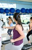 stock photo of step aerobics  - group of women at the gym doing aerobics - JPG