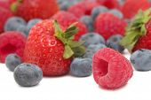 Scattered Strawberry, Blueberry And Raspberry (isolated)