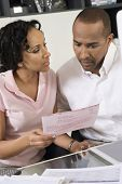 African American couple worried over excess domestic bill poster