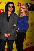 LOS ANGELES - JAN 23:  Gene Simmons, Shannon Tweed Simmons arrive at the