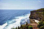 pic of dua  - High cliffs covered by green trees above the blue sea Nusa Dua Bali Indonesia - JPG