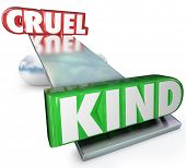 The words Cruel and Kind on a balance or see-saw to illustrate the difference in demeanor between cruelty and kindness and the fact that good gestures and nice attitude win out
