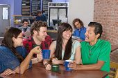 foto of social housing  - Cheerful group of people socializing in a coffee house - JPG