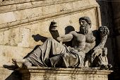 stock photo of horn plenty  - Statue with horn of plenty at Piazza del Campidoglio in Rome - JPG