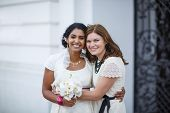 foto of indian wedding  - Beautiful happy indian bride and her friend after wedding ceremony