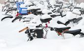 European City Winter Fragment. Bicycles Covered With Snow In Big Snowdrift