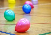 Colorful Balloons On Wooden Floor Of Sports Hall