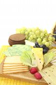 pic of grated radish  - Slices of cheese with grapes radishes and bread - JPG