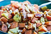 stock photo of hash  - Sweet potato hash, a perfect dish for the holidays. Diced potatoes fried with apples and seasoned with parsely and walnuts.