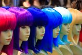 mannequin with colorful wig and facial accessories