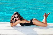 pic of one piece swimsuit  - beautiful woman in black one - JPG