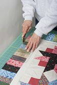 Quilter Trimming  Piano Keys Of Quilt Top Fabric.