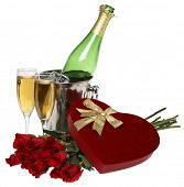 Valentine's day still life with heart shaped chocolate box, champagne bottle, glasses, and doze roses