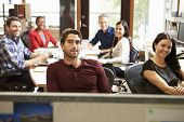 stock photo of pacific islander ethnicity  - Portrait Of Office Staff At Table In Architect - JPG