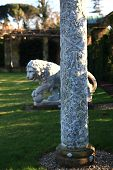 HEVER CASTLE AND GARDENS, KENT, UK - MARCH 10, 2014: Lion sculpture and decotative post in 250 acre