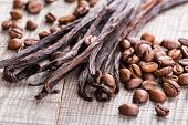 stock photo of bean-pod  - vanilla pods and coffee beans on wooden background - JPG