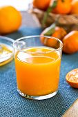 stock photo of clementine-orange  - Fresh Orange juice by some Oranges and Orange squeezer - JPG