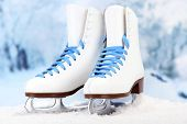 Figure skates on winter background