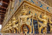 picture of garuda  - Guardian Garuda support the base of Wat Phra Kaew Temple of Emerald Buddha in Grand Palace the iconic landmark in Bangkok Thailand - JPG