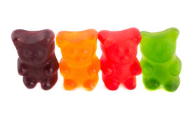 pic of gummy bear  - Row of colorful gummy bears on isolated white background