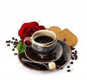 Cup Of Black Coffee And Red Rose Flower Over White