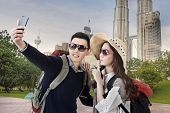 picture of malaysia  - Asian couple travel and selfie in Kuala Lumpur - JPG