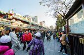 Tokyo, Japan - November 21, 2013: Tourists Visit Nakamise Shopping Street In Asakusa