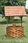 pic of water well  - Well made of wood in a park - JPG