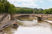 People On The Promenade And Bridge Across The Tiber In Rome, Italy