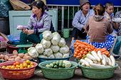 woman sell fresh vegetable at street market