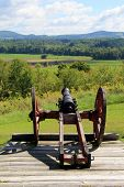 picture of artillery  - Example of heavy artillery on wood platform in pretty,scenic meadow, where wars were fought in the shaping of America.
