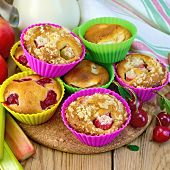 Cupcakes With Rhubarb And Cherries In Tins On Board