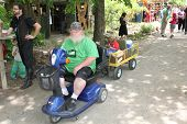 MUSKOGEE, OK - MAY 24: Man in a wheelchair enjoys her day at the Oklahoma 19th annual Renaissance Festival on May 24, 2014 at the Castle of Muskogee in Muskogee, OK.