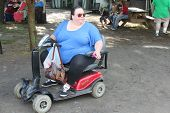 MUSKOGEE, OK - MAY 24: Woman in a wheelchair enjoys her day at the Oklahoma 19th annual Renaissance