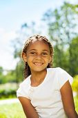 Close portrait of black girl in the park