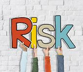 Group of Diverse People's Hands Holding Risk