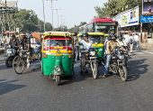 Transporting People Through City On Auto Rickshaw