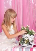 Beautiful tender girl i holds bouquet of flowers