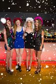 stock photo of hen party  - Laughing friends having a hen party at the bar against snow falling - JPG