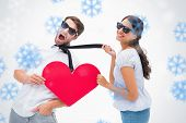 Brunette pulling her boyfriend by the tie holding heart against snowflakes