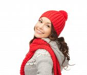 winter, christmas, holidays, clothing and people concept - smiling asian woman in red hat and mitten